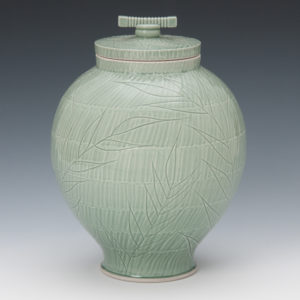 Ceramic vase with light green leaves