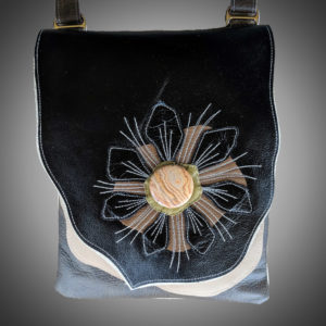 Purse with a stitched flower
