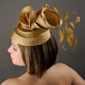 Women's tan hat with feathers