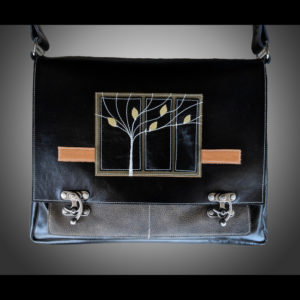 Black purse with trees