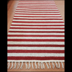 Fiber rug of red and white striped