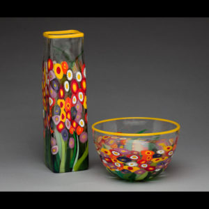 Glass bowl and vase with flowers
