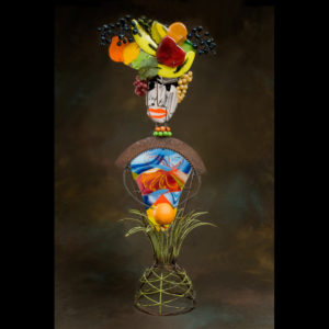 Glass artwork of a person with fruit