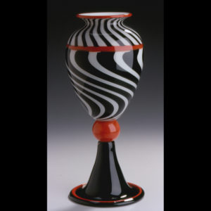 Glass vase with black, white and red