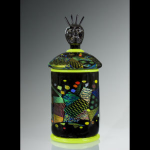 Glass sculpture with black and yellow shapes