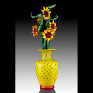 Glass sculpture of a vase with flowers