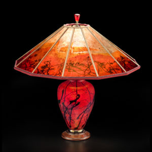 Glass lamp with red and black