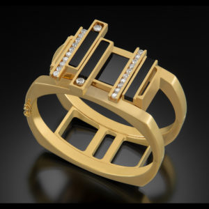 Gold ring with black stone and diamonds