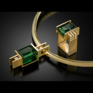 gold jewelry with green stones