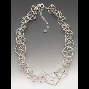 Silver necklace with various shapes