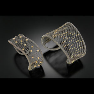 Mixed metal cuffs with gold