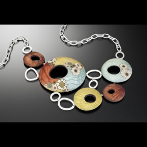 Silver necklace with various shapes and pendants