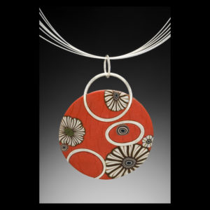 Red necklace pendant with flowers