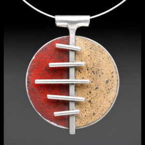 Silver pendant with red and tan