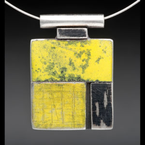 Silver necklace pendant with yellow and black