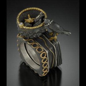 Mixed metal ring with birds nest