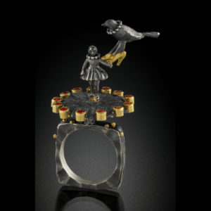 Mixed metal ring with a little girl and a bird
