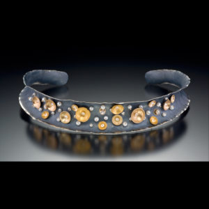 Gray cuff with gold and pearls