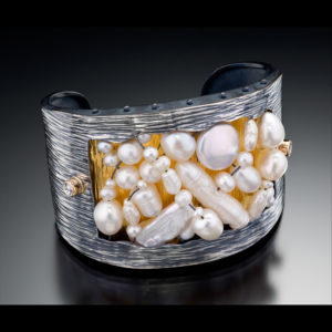 Silver ring with gold and pearls