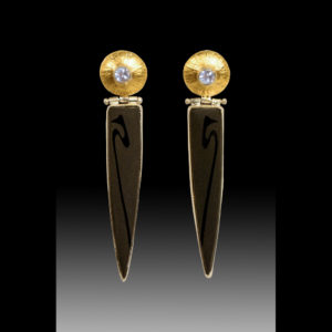 Gold earrings with silver and black