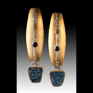 Gold earrings with blue, black, and gold