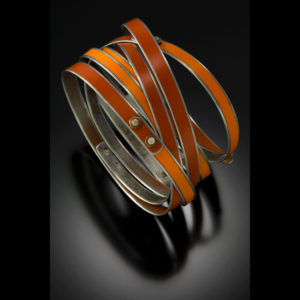 Orange and silver ring