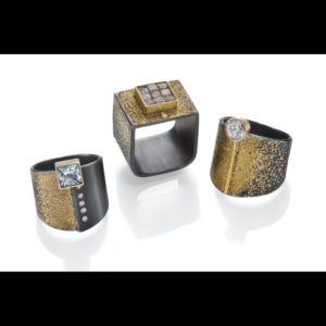 Mixed metal rings with diamonds