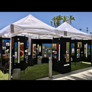 Art display with palm trees in the background