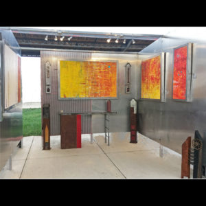 Art display with metal work and paintings