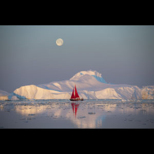 Photograph of ice, red boat, and the moon