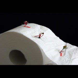 fake people skiing down a roll of toilet paper