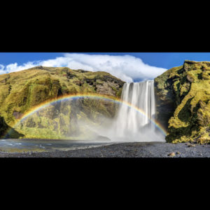 Photograph of a waterfall with a rainbow