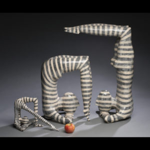 Flexible people sculptures with an apple