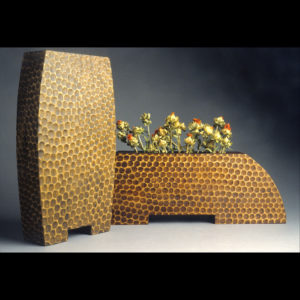 Wooden vases with flowers in them