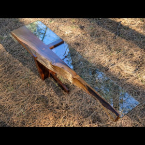 Narrow wooden table with glass