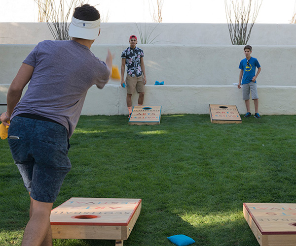Corn hole being played at the Arts Festival