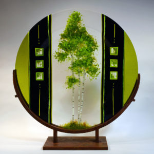 glass sculpture with painted tree